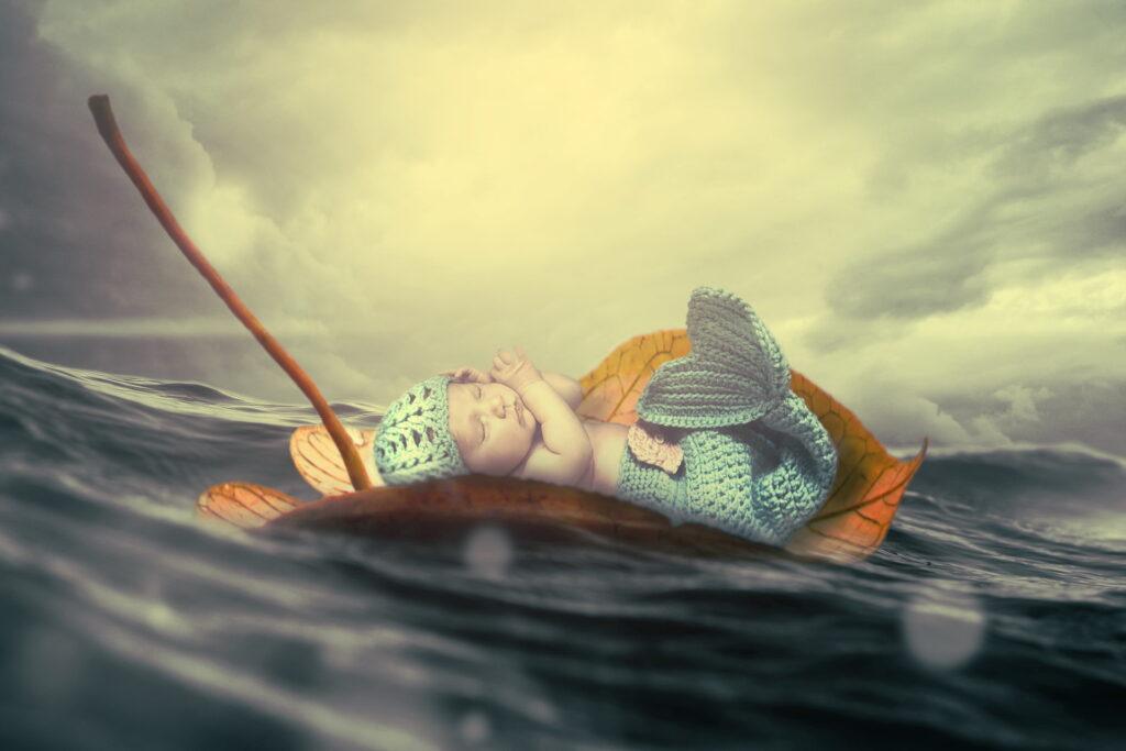 Suočavanje sa tugom i patnjom. Dete na listu spokojno plovi kroz nemirne vode.